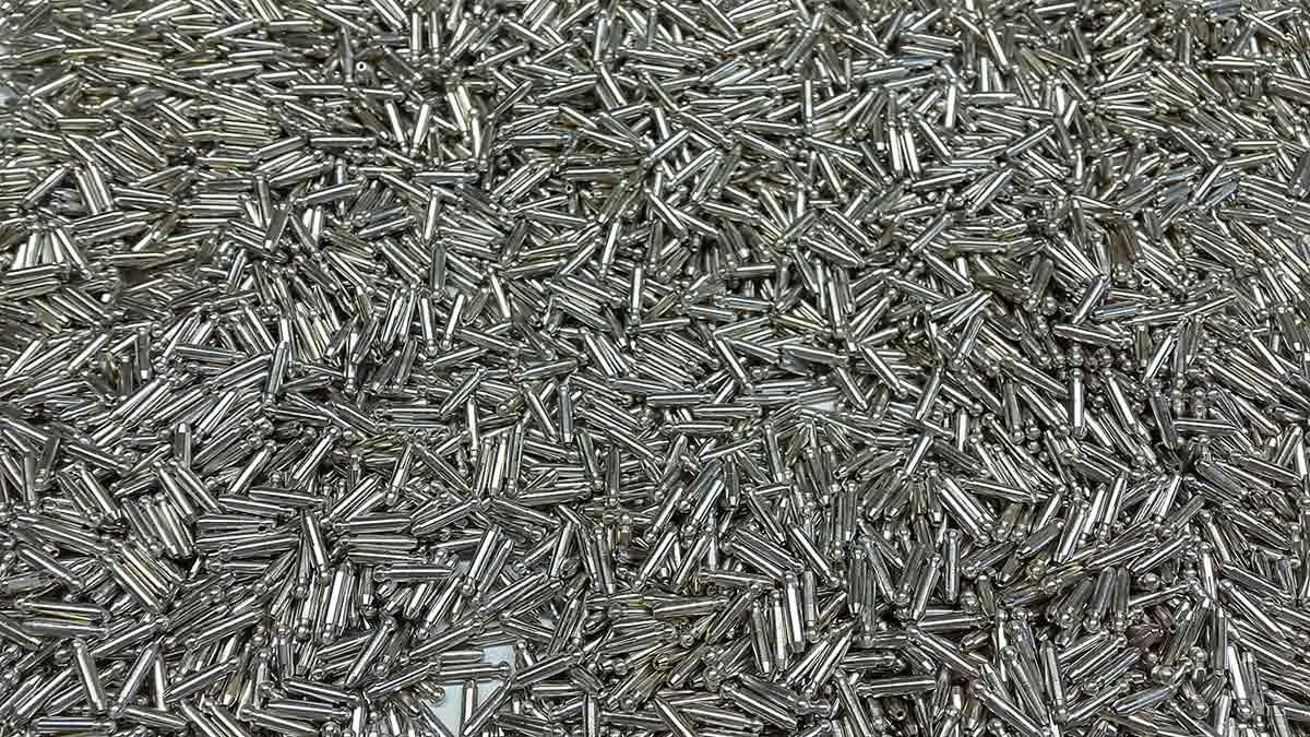 Lega ternaria, trattamento spessore 2 micron su pin in ottone